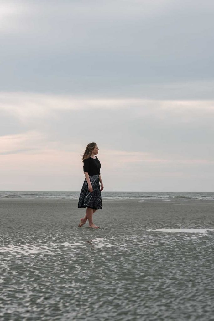 Courtney Khail standing on st simons beach